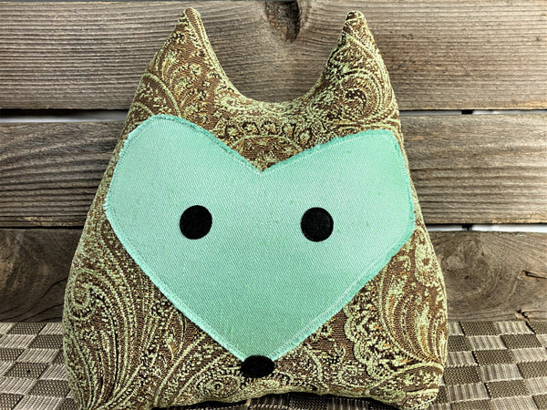 Brown paisley fox pillow with mint green face