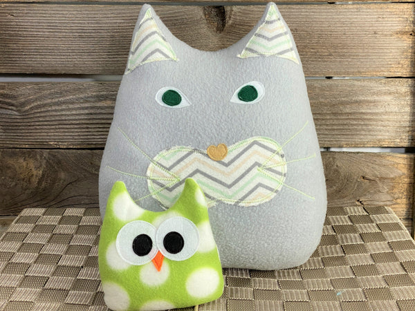 Gray cat pillow with chevron print and a green and white polka dot owl hot and cold pack