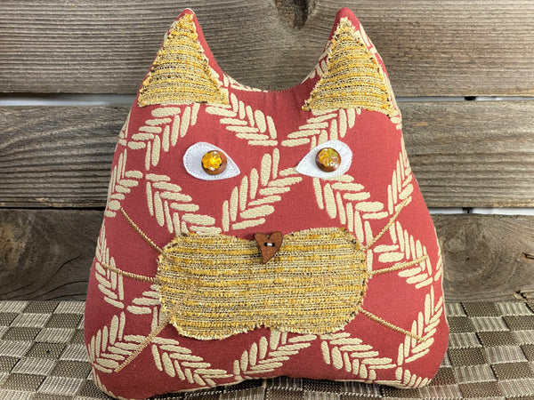 Terra cotta and cream cat pillow with tropical vibe