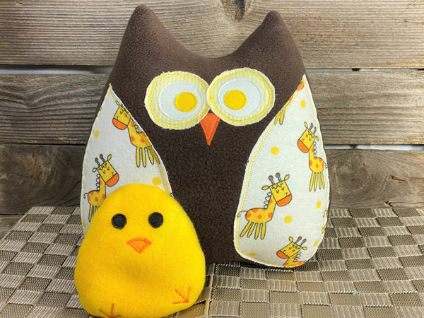 Brown owl pillow with giraffes and a yellow hot and cold chick for boo boos