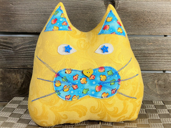 Yellow cat shaped pillow with fish print