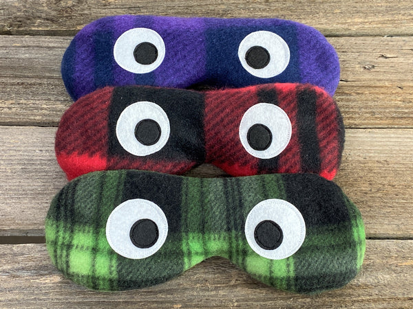 Eye masks in purple red or green plaid prints