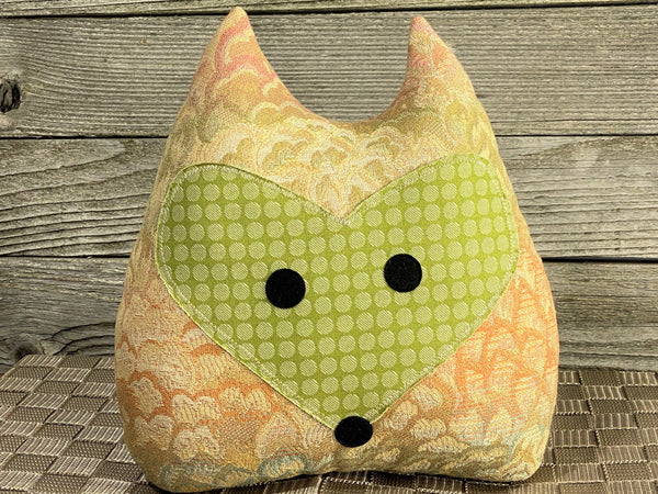 Fox pillow with green, orange, and cream fabric