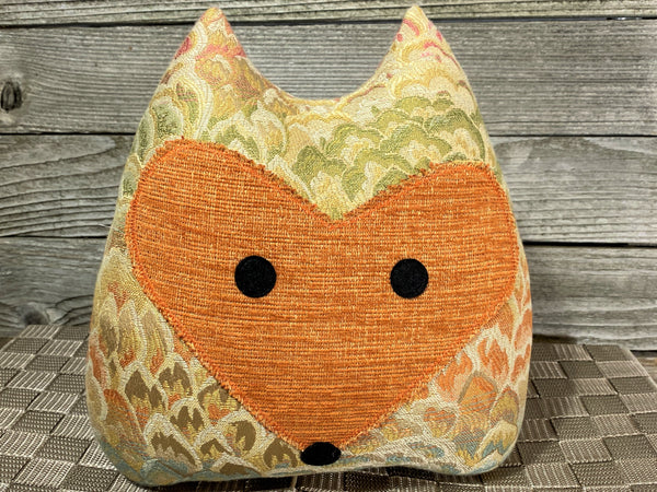 Fox pillow with multicolor neutral fabric and burnt orange accents