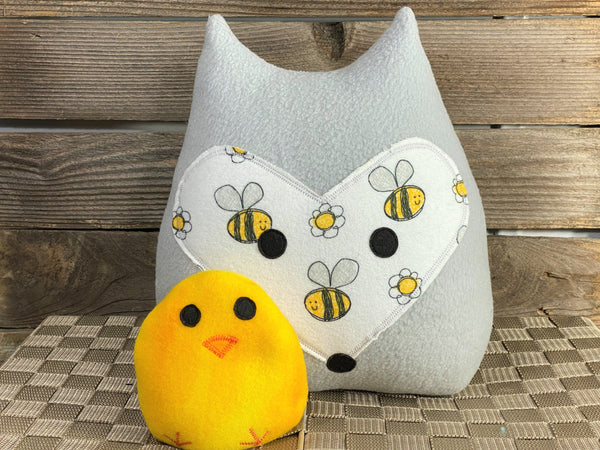 Gray fox pillow with a bumblebee print and a yellow chick hot and cold pack