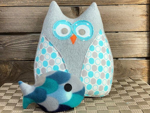 Gray owl pillow with teal dots and a blue hot and cold fish for boo boos