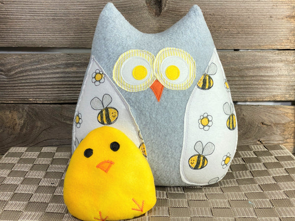 Gray owl pillow with bees and a yellow hot and cold chick for boo boos