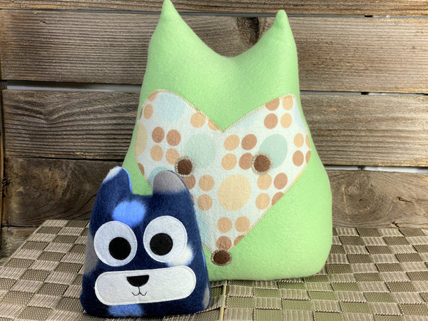 Pale green fox pillow with tan green and yellow polka dots with a blue cat hot and cold pack