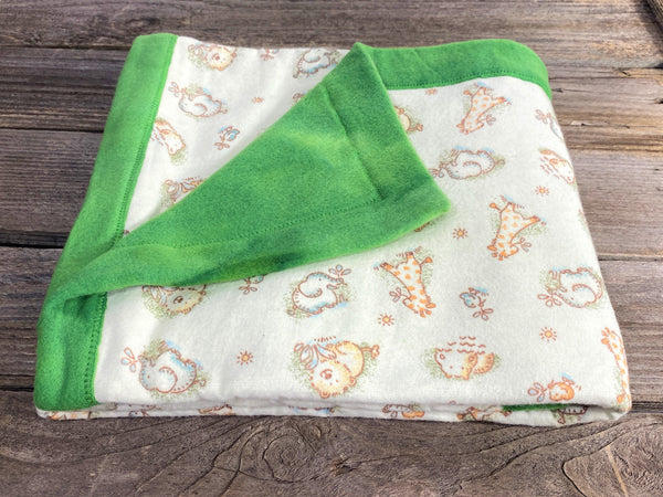 All purpose baby mat with jungle kritters and green tie dye backing