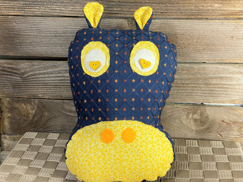 Navy blue hippo pillow with yellow accents