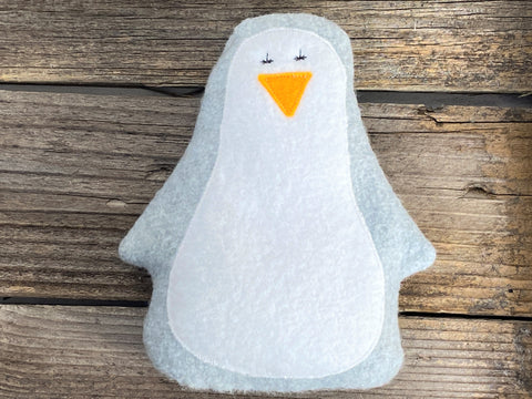 Gray penguin for use as hot or cold pack