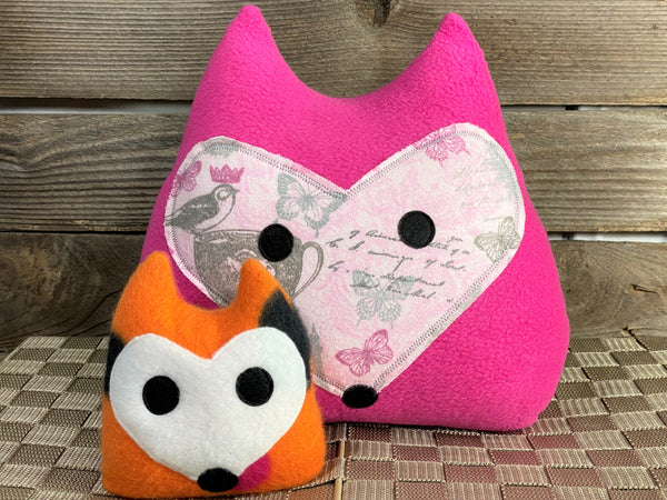 Hot pink fox pillow with pink and gray roses birds and butterflies with an orange fox hot and cold pack