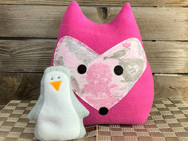 Hot pink fox pillow with pink and gray roses birds and butterflies with a gray penguin hot and cold pack