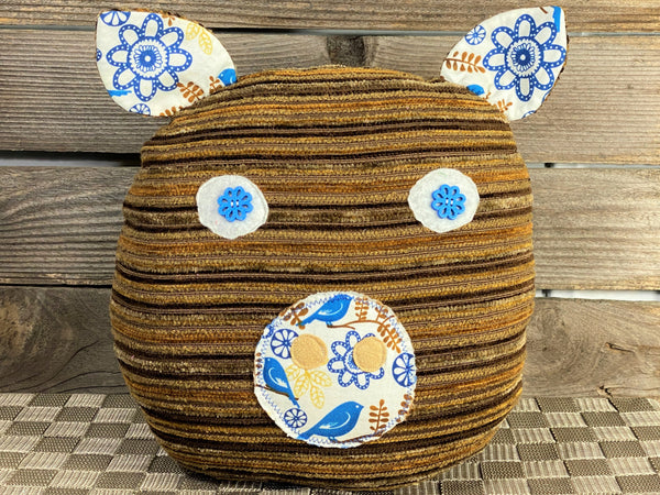 Brown striped pig pillow with brown and blue bird print