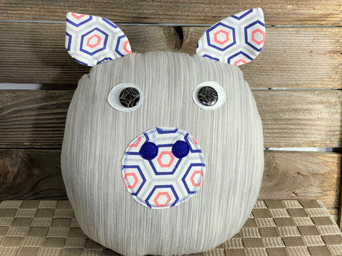 Gray striped pig pillow with melon and royal blue accents