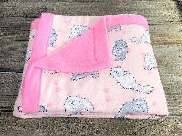 All purpose baby mat with gray and white long haired kitty cats and pink backing