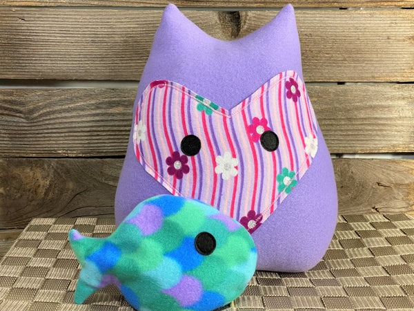 Lavender fox pillow with pink and purple stripes and flowers with a fish hot and cold pack