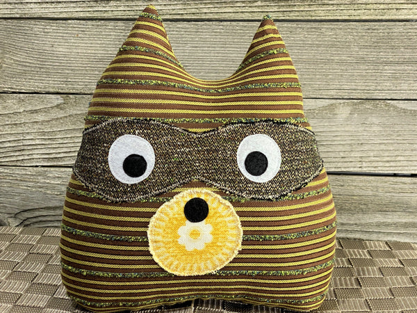 Brown and yellow striped raccoon pillow