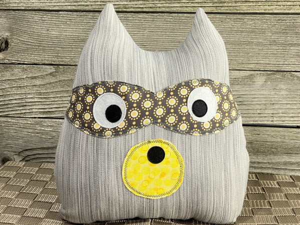 Gray and yellow striped raccoon pillow