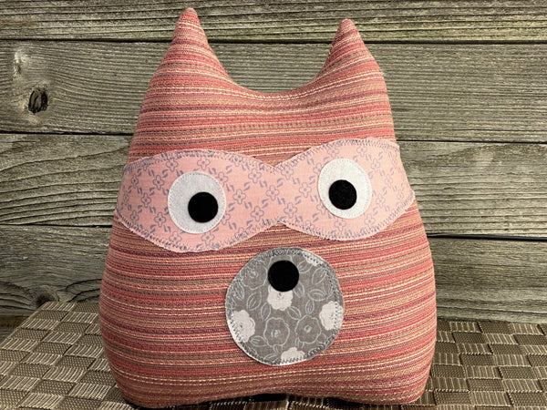 Raccoon pillow made from vintage pink striped fabric and with pink and gray accents
