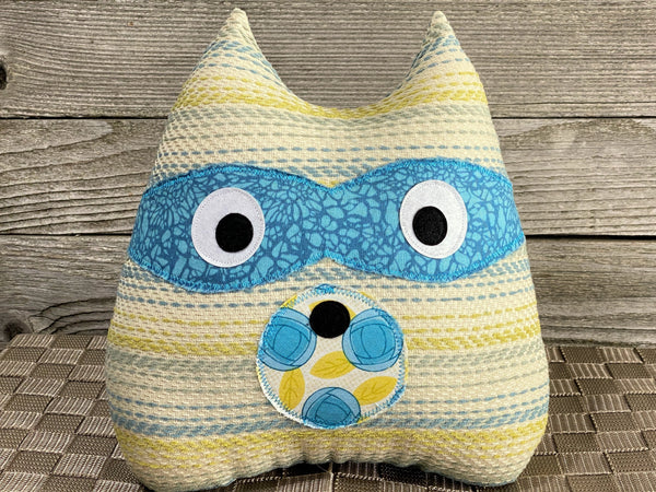Striped raccoon pillow in gray teal and yellow