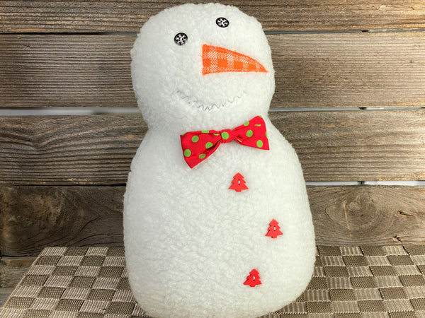 Snowman pillow with red bowtie with green dots and red pine tree buttons