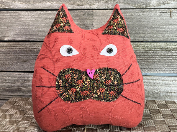 Terra cotta and black cat pillow with floral print