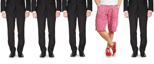 four businessmen wearing black suits, one businessman wearing a white t shirt and pink shorts