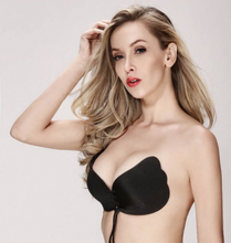 beautiful model wearing our black strapless bra
