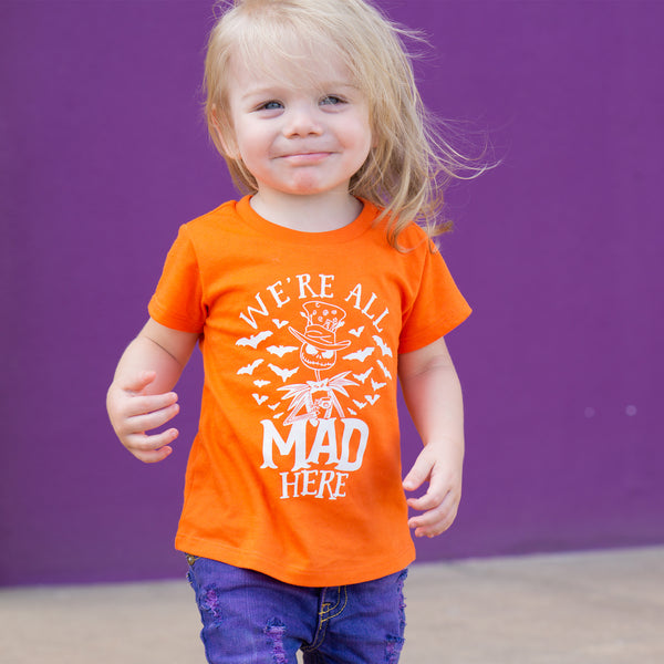 We're All Mad Here Orange Kids Tee  |  White Ink