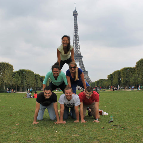 Making a human pyramid in front of the Eiffel Tower