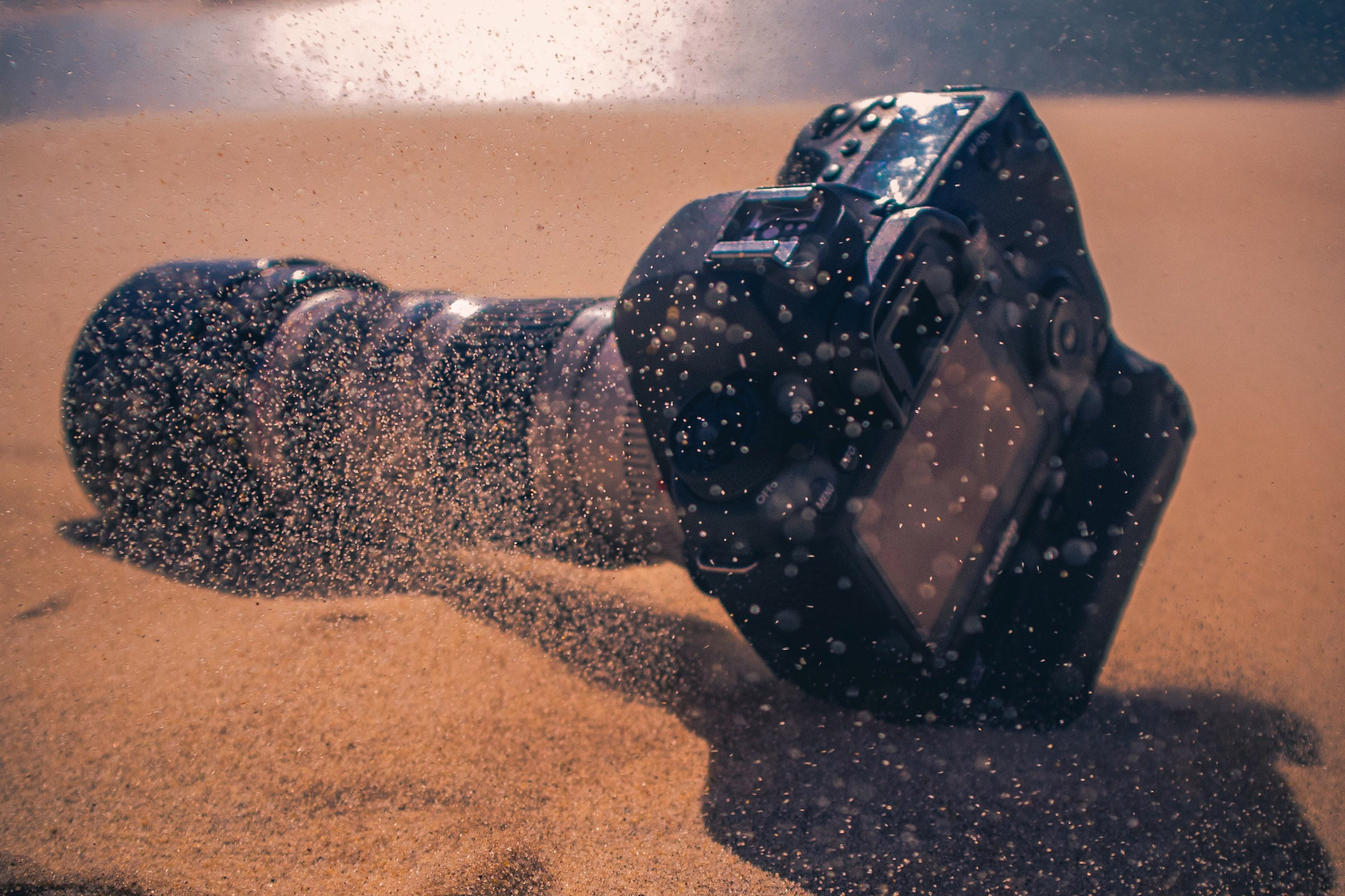 sand gets in a camera while hiking in the desert