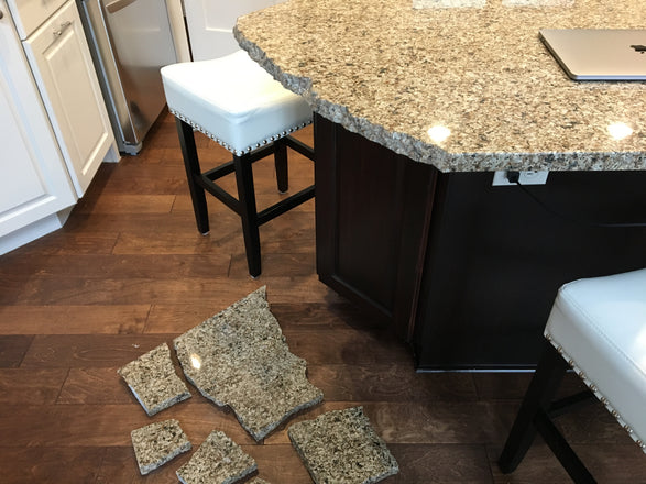 Pictured is a broken granite countertop showing you why you need to support the granite overhangs with brackets or corbels.