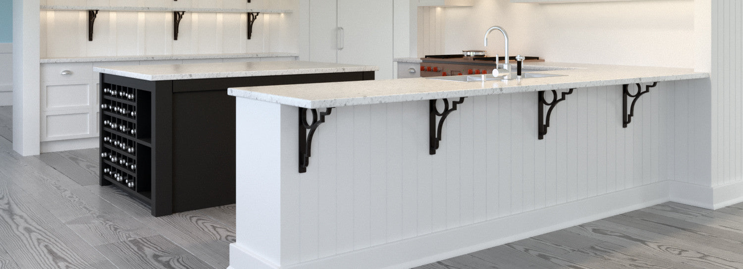 Wrought iron corbels being used to support a granite kitchen countertop overhang
