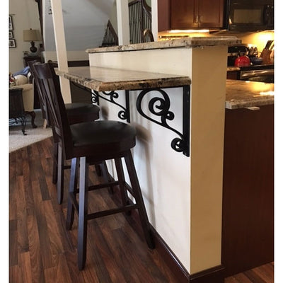 This is a picture of our 2-inch wide scroll corbel supporting a customers stone bar.