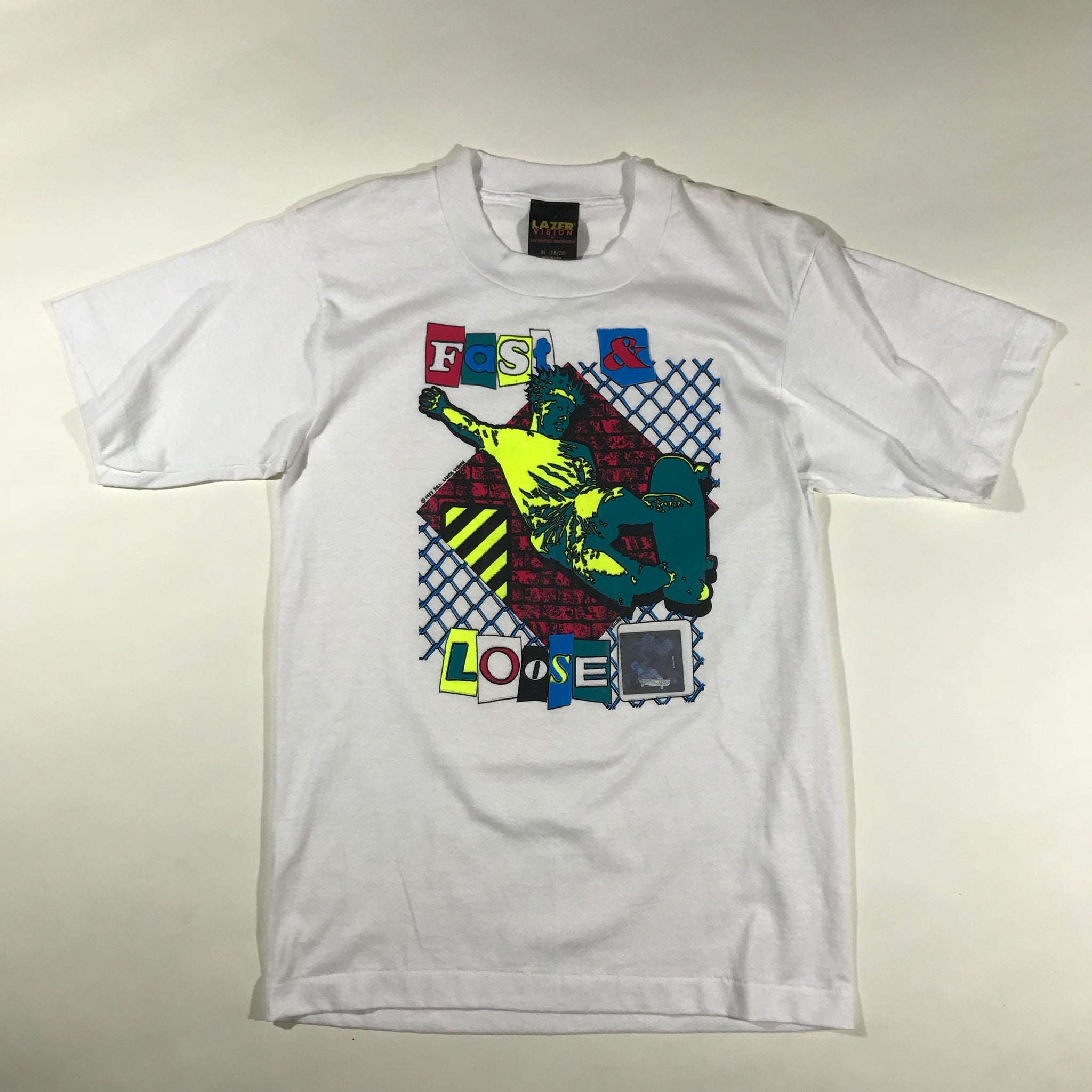 Fast and Loose holographic skate tee. small fit.