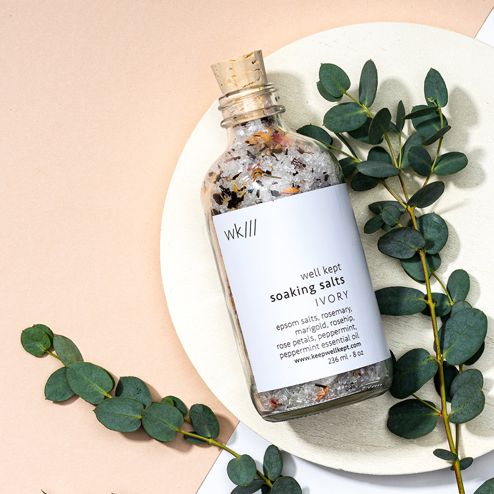 Elate Ethical Marketplace. Give the gift of a relaxing bath this christmas with Well Kept rosemary epsom salt bath salt. Comes in a reusable glass bottle, perfect for sustainability. Also contains marigold, rosehip, rose petals, peppermint essential oil.