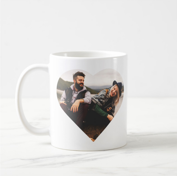 Heart Shaped Photo Template of couple looking and laughing at each other on a basic white 11 oz mug