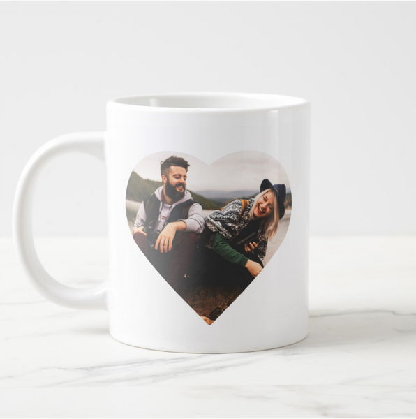 Heart Shaped Photo Template of couple looking and laughing at each other on a basic white 20 oz jumbo mug