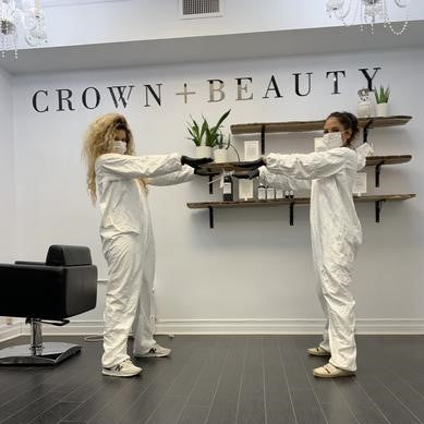 Vanessa and Megan inside Oakville salon with protective gear, following new safety measures for COVID-19.