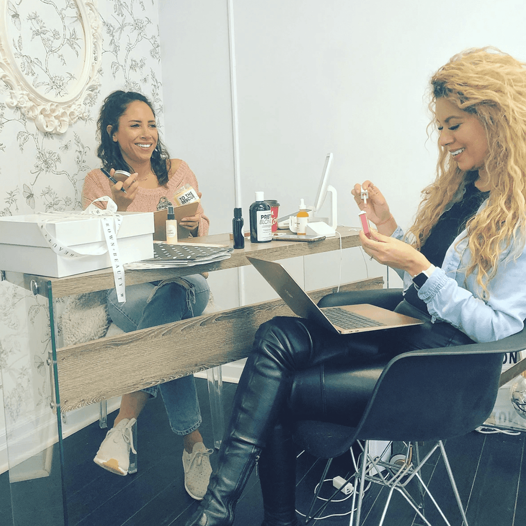 Megan and Vanessa working on formulating the ingredients for their exclusive natural vegan hair and skincare products.