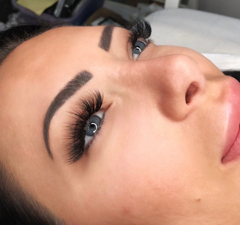 Crown + Beauty's client after hybrid fill lash extension treatment for long, full and gorgeous lashes.