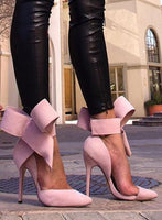 The Bowtie Pointed Pumps in the color pink. At The Urban Doll.