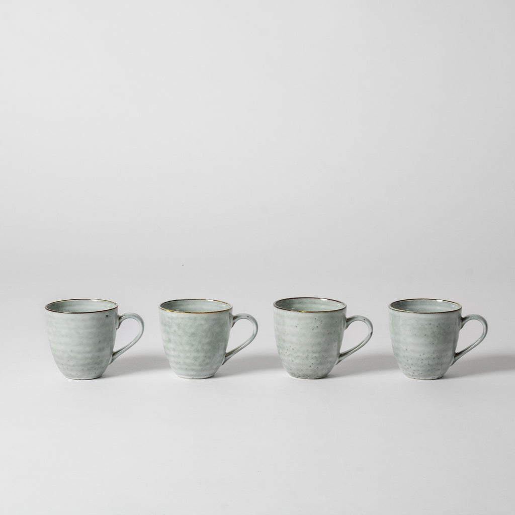 Blue speckled coffee mugs