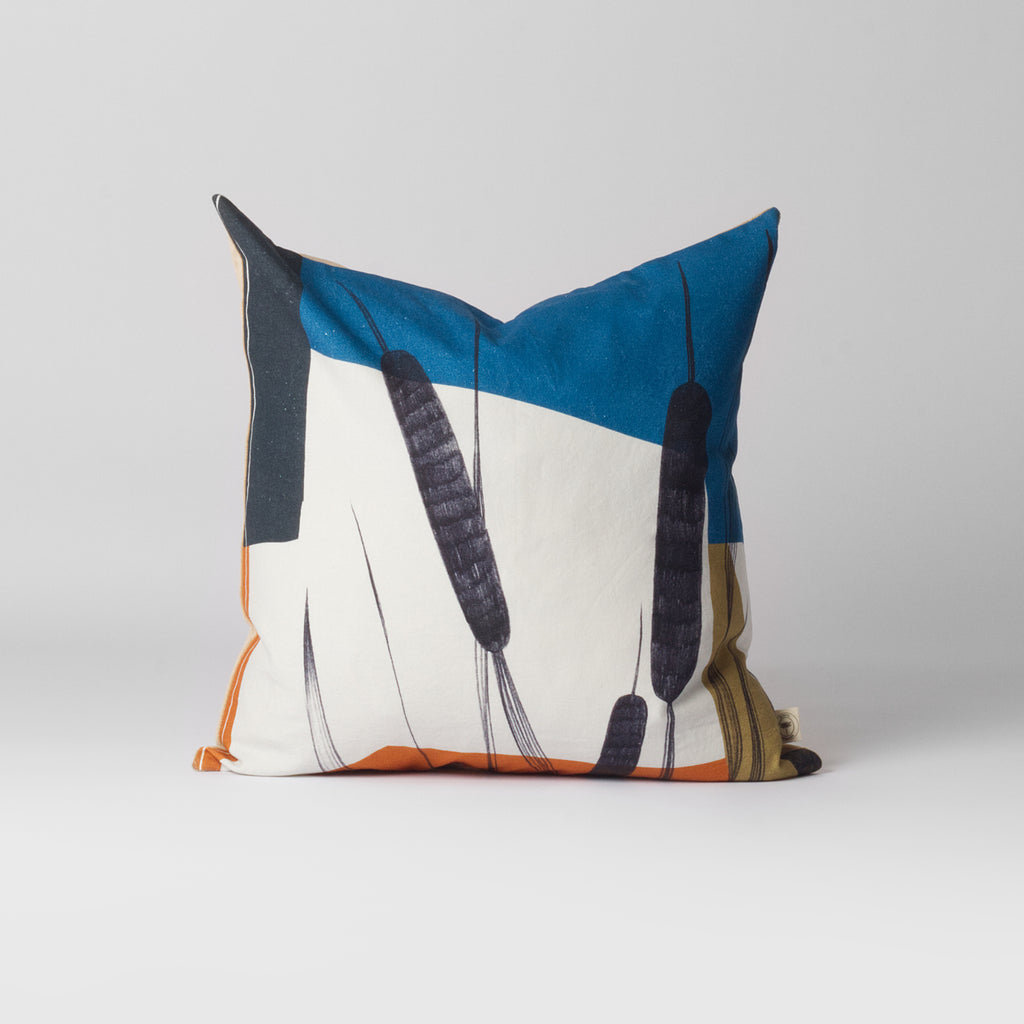 blue and white pattern cushion