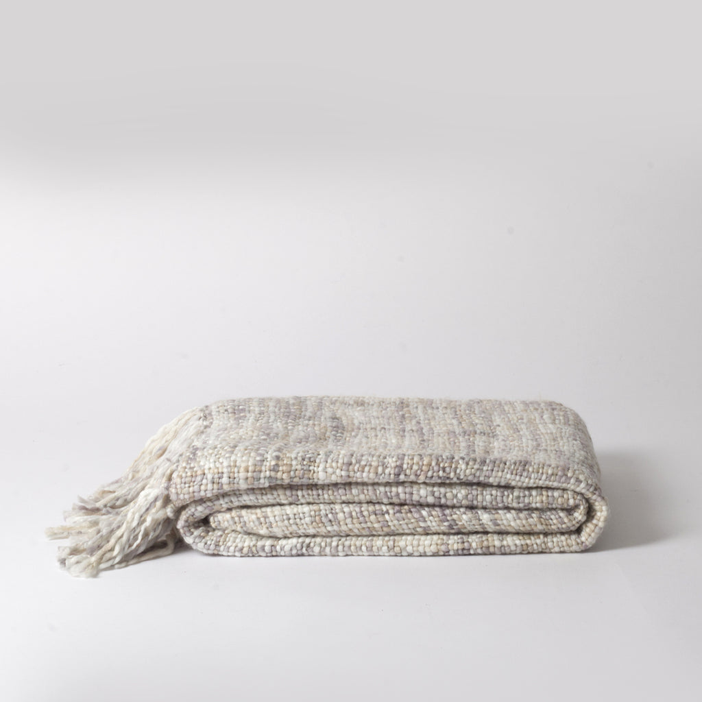 cream knitted throw
