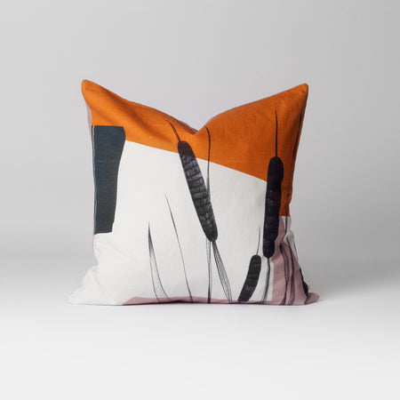 orange and white printed cushion