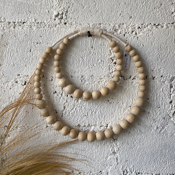 ROUND DOUBLE NATURAL BEADS