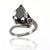 Pear Shape Black Diamond Solitaire Ring With Ruby Single Accent