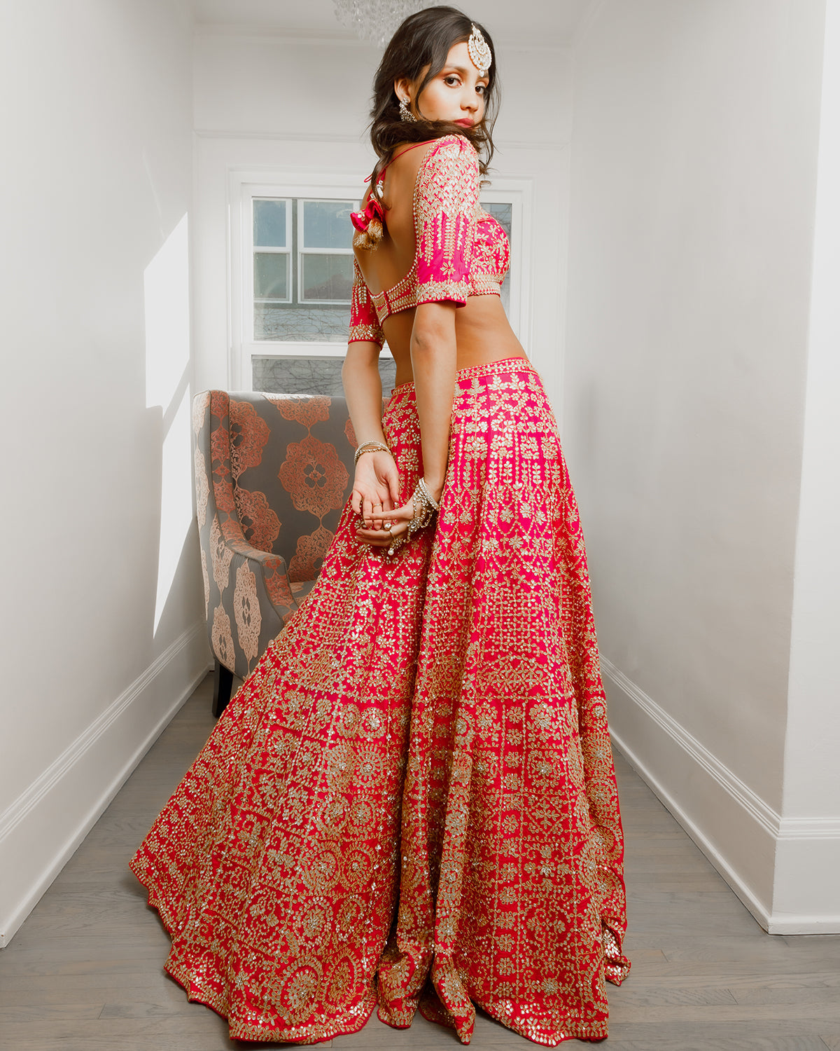 Fuchsia and gold mirror bridal lehenga